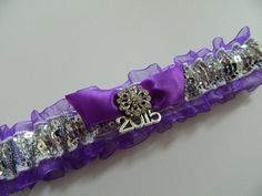 An elegant prom garter with silver Sequins and purple organza. This prom garter is embellished with bow and 2015 charm, centered a sparkling rhinestone. ~~~ ~~My wedding garter are made-to-order and