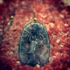 """Worldwide Inspirations"" A hand crafted pendant of a natural agate moss ""Kuan Yin"" figure amulet  binded with agate moss minerals and the finest gold plated silver."