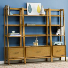 Features: -Ladder style bookshelf. -Large file- style drawer. Product Type: -Etagere. Style: -Modern/Mid-century. Frame Material: -Wood. Shelving Included: -Yes. Drawers Included: -Yes. Orient