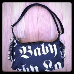 LAMB by Gwen Stefani for LeSportsac LOVE ANGEL MUSIC BABY all over print. Original design by Gwen Stefani. Sold as-is. No holes, slight scuffing on the hardware. Not a brand new bag, very loved but tons of life left! Needs a cleaning but it's a small very cute vintage little bag perfect for short outings! Reasonable offers considered! ❌NO TRADES❌ L.A.M.B. Bags Mini Bags