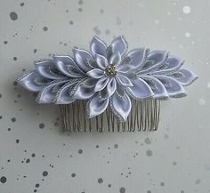 Handmade Kanzashi flower hair comb <br> <br>Would look great for weddings, christening or any special occasion <br> <br>Made using quality double satin ribbon and glittery organza ribbon <br> <br>Can be made in other colours <br>To match your outfit <br> <br>Appox size of comb is 8cm <br>and <br>appox size of flower is 12 and half cm in lenght <br> <br>Thank you for taking the time to look at my items <br>Please feel free to message me with any enquiries <br> <br>Made using double satin Corsage Wedding, Hair Comb Wedding, Bridal Hair, Pearl Flower, Flower Hair, Flowers In Hair, Decorative Hair Combs, Hair Comb Clips, Kanzashi Flowers