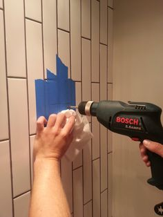 How To Drill Into Tile... Get a ceramic drill bit, tape the spot you want to drill, keep drill tip cool (in the post they say to keep dipping it in water, but I think on rehab addict someone literally pour water on the bit as they drilled)