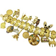 Massive Vintage 18k Yellow Gold Travel 20 Charm Bracelet Gold Coins 150 grams ..