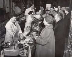1955. Avondwinkel (night store) in Amsterdam. During the 1950's and 1960's store opening hours in Amsterdam were limited. Stores had to set their opening hours between 05:00 to 18:00 on Monday to Saturday. There was a mandatory closure on Sunday. Avondwinkels had a special license which allowed them to be open at night and on Sunday. Photo Spaarnestad. #amsterdam #1955 #avondwinkel
