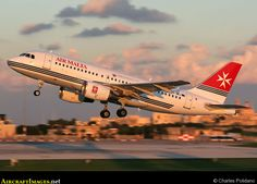 Air Malta Airbus A319 9H-AEJ Taking off from Luqa, Malta.