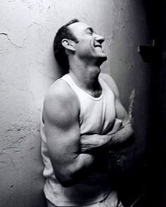 Kevin Spacey showing off his guns, 90s