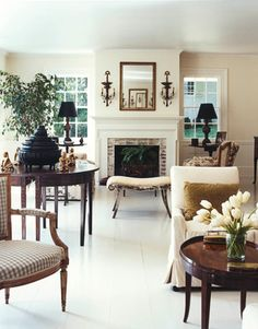 """Painted floors! -- Original comment: Uncluttered Space -- In small spaces, it's important to keep things as simple as possible. This living room boasts clean, neutral-colored walls and the original floors painted a cool shade of gray. The absence of rugs and small trinkets on tables keeps the """"fussiness"""" to a minimum."""