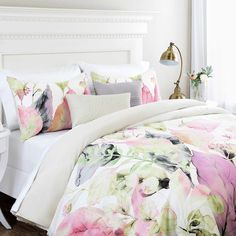 Revive the look of your bedding with the vibrant colors in the Belvedere Row Meadow Reversible Comforter Set. The lovely bedding is adorned with a contemporary floral motif in rich hues of pink, green, and charcoal and reverses to a soothing, solid tan. Designer Comforter Sets, Big Beds, Dreams Beds, Bed Springs, Bedding Shop, Chic Bedding, Comforters, Bedspreads, Home Furniture