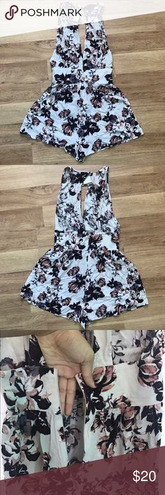 K&K Floral Romper Floral romper with an open back, cutout in the front, and waistband Kendall & Kylie Dresses