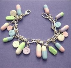 Pill bracelet, haha this is cut... but i doubt i could wear it to school