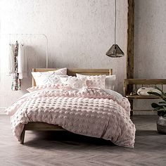 Embellish your slumber with the divinely cosy chenille spots of the cotton Haze Quilt Cover Set from Linen House.