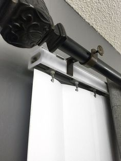Easily hang curtains and dramatically change the look of any room by attaching this bracket to your outside mounted vertical blinds. * Specially Engineered for Blind Attachment * Outside mounted vertical blind head rail attachment * Fits 1 inch curtain rod * 1.5 - 2 inch Adj