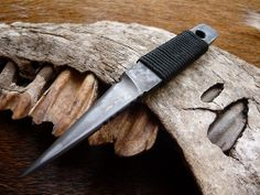 The black Crow .  I love looking at Nature for inspiration especially for my knife blade shapes and have recently been re looking at bird's beaks . The Crows beak kiridashi was made from 5mm thick 52100 bearing steel which was jimped in 3 key areas for traction control and I added a top swedge to add a needle like tip to the beak .  It was then etched in ferric chloride , the mirror polished edge and top swedge have gone a deep  dark color creating a great contrast with the flat of the blade…