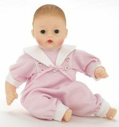 Madame Alexander Perfect Little One Huggable Huggums by Alexander Doll Company. $52.81. Doll is dressed in a pink romper with a white sailor collar that has white piping, simulated buttons and a pink ribbon bow. She has blue eyes, soft body, and vinyl hands and feet.