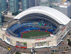 Rogers Centre-Rogers Centre is a multi-purpose stadium in downtown Toronto, Ontario, Canada situated next to the CN Tower near the shores of Lake Ontario Baseball Scoreboard, Baseball Park, Sports Baseball, Baseball Tickets, Baseball Backgrounds, Baseball Wallpaper, Baseball Game Outfits, Stadium Architecture, Baseball Classic