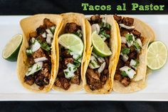 tacos al pastor: spicy pork tacos with grilled pineapple and onion