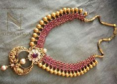 Ruby necklace with a touch of traditional design from Nikitha Linga in Hyderabad attached to a chand bali shaped nakshi work pendant in twin peacock design India Jewelry, Temple Jewellery, Fine Jewelry, Gold Jewelry, Jewellery Shops, Diamond Jewelry, Jewelry Sets, Antique Necklace, Antique Jewelry