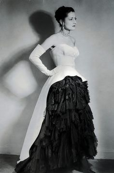 A very eye-catching gown of black silk organza and white cotton pique from 1951