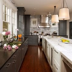 Another example of two tones of cabinets - I think I would prefer a black-brown color as the darker cabinet to contrast with the white if we were to do two tone.