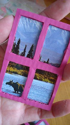 Adding windows to my Shoebox Dollhouse.  Step 4   Find a nature scene in a magazine.  Cut it out and glue it to the back of your window frame.