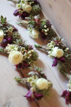 White spray rose and succulent boutonniere