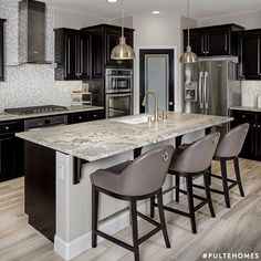 Design Inspiration: A gorgeous, modern Pulte kitchen, featuring black and grays. | Pulte Homes