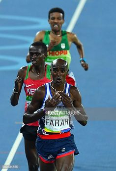 Britain's Mo Farah reacts as he crosses the finish line in the Men's 10000m during the athletics event at the Rio 2016 Olympic Games at the Olympic...