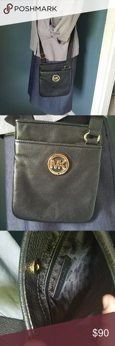 Michael Kors crossbody black leather purse Perfect condition, used maybe twice, just not enough room for my junk :P Michael Kors Bags Crossbody Bags