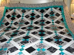 Disappearing 9 patch with lattice and corner stones. Like the use of B and W with one bit of accent color