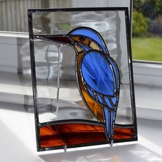 A Kingfisher with beautiful blue and gold plumage from Radiance Stained Glass.