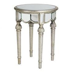 Mirrored end table with spindle legs and an antiqued silver finish.Product:   End tableConstruction Material: Mirrored glass  Color: Antique silver   Dimensions:  30 H x 23 Diameter