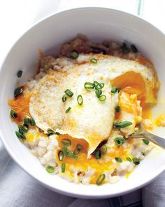 Oatmeal just took a savory turn. Scallions, cheddar cheese, and an egg