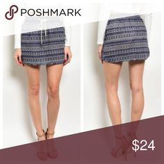 Tribal Mini Skirt Fun and flirty! Navy mini skirt with an all over tribal print and a drawstring closure. The skirt is 14 inches long and made of 80% viscose/ 20% linen. Available in small, medium, and large. Skirts Mini