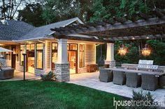 A paver patio extends off the pool house and serves as the base of the outdoor dining area.