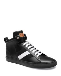 Bally's signature trainspotting gives these high tops a signature flair. | Leather/rubber | Imported | Fits true to size, order your normal size | Leather upper with trainspotting | Rubber sole | Web