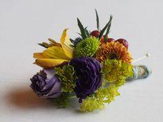 vibrant colours, purple, orange, yellow and lime green, cluster of lisianthus, kermit, thistle, alstroemeria, bupleurum, brown hypericum berries