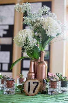 Rustic Wine Bottle Wedding Centerpiece / http://www.himisspuff.com/rustic-wedding-centerpiece-ideas/14/