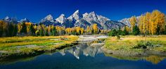 Grand Teton National Park may share a border with Yellowstone, but the two parks might as well be worlds apart. Yellowstone is known for its geothermal natural w Us National Parks, Grand Teton National Park, Vacation Destinations, Vacation Spots, Vacation Ideas, Vacations, Monuments, Beautiful Landscapes, Land Scape