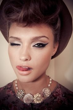 her eye makeup is amazing!  but the cat eye tail is a bit to long for my taste
