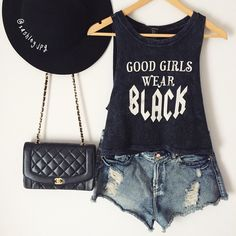 Black statement singlet with ripped jean shorts, a sleek jet black brimmed hat, and a black Coco Chanel handbag