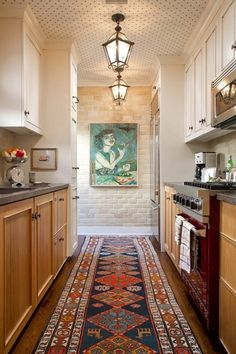 tuxedo galley kitchen, vintage rug, polka dots on the ceiling!!