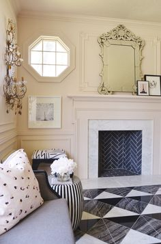 {styled space} Gray #Fireplace | Christine Dovey : http://curatedinterior.com/inspiration/styled-space-modern-elegance-christine-dovey/