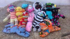 A family gathering of handmade sock monkey toys. #sockmonkey #handmade #crafts #DIY #teddy #odsox