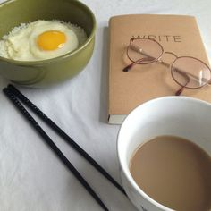 Jared made breakfast for Julie.  White rice with egg, coffee, and a writing book with notes he wrote for her.