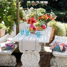 """Concrete furniture on garden patio"" creates a beautiful tablescape, post by housetohome.co.uk"