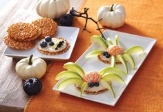 Creepy Creature Fruit Pizza  You'll need: –pizelle cookies -8 oz cream cheese -1/4 cup light brown sugar -1 tsp vanilla -fruit: mandarins, apple slices & blueberries  Directions:Beat the cream cheese, light brown sugar & vanilla until smooth. Spread the mixture onto each pizelle cookie and decorate with fruit. Half a mandarin orange, blueberries and thinly-sliced Granny Smith apples create the cutest spiders and skulls. Get creative or set out the fruit and let the kids make their own…