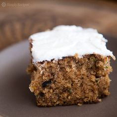 BEST Zucchini Cake! This is my grandmother's recipe for a gently spicy sheet cake, made with freshly grated zucchini. So good! On SimplyRecipes.com #dessert #baking #cake #zucchini