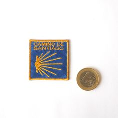 (http://www.spanishdoor.com/camino-de-santiago-pilgrim-st-james-scallop-shell-road-marker-mini-cloth-patch/) #CaminoDeSantiago #ScallopShellMiniPatch