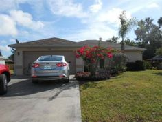 Build in 2002; Charming Home with tile floors, cathedral ceilings, breakfast bar, eat-in kitchen, split bedrooms, garage convert in a Mother-in law Suite, (garage easy to be returned to original 2 car garage) and a screened lanai.