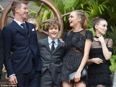 Fun and games! Cara and her co-stars Garrett Hedlund (left), Levi Miller (second left) and...